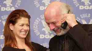 In a 2001 photo, actress Debra Messing and director James Burrows pose together after Burrows won a Directors Guild of America award for directing the pilot of Will & Grace.
