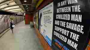 New Yorkers Rush By As Embattled Anti-Jihad Ads Hit The Subway