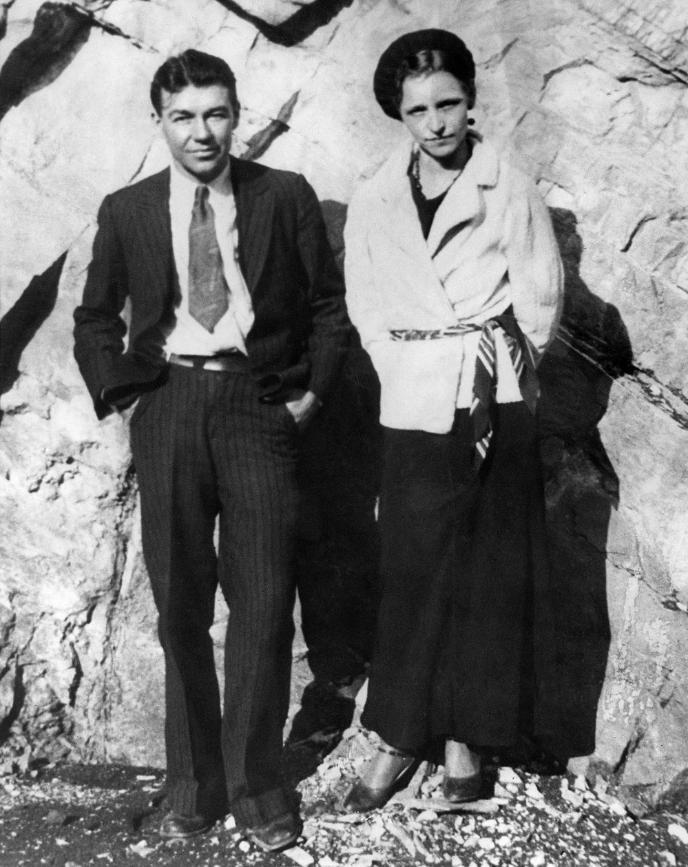 A photograph taken sometime between 1932 and 1934 shows Bonnie Parker and Clyde Barrow. The couple captured headlines with a long crime spree before being shot to death in an ambush in Louisiana.