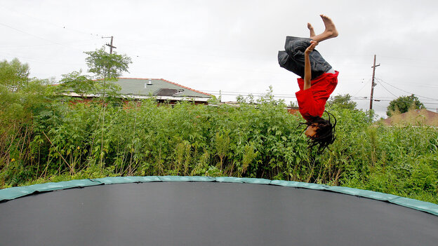 Eric Wiltz cavorts on a  trampoline in New Orleans in  2010. Everything is fun and games on the backyard attractions until someone gets hurt, a leading group of pediatricians s