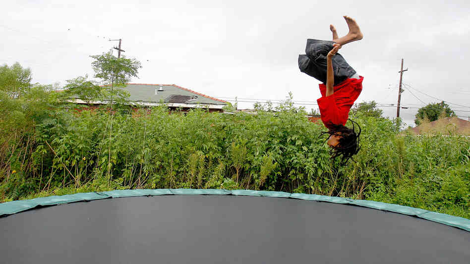 Eric Wiltz cavorts on a  trampoline in New Orleans in  2010. Everything is fun and games on the backyard attrac