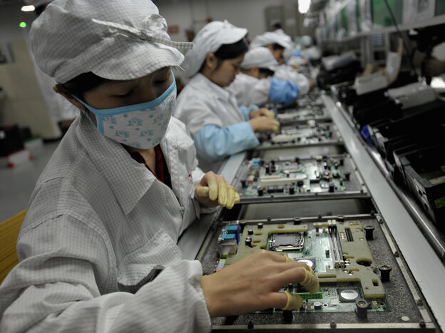Workers at a Foxconn plant in Shenzhen, China, in 2010.