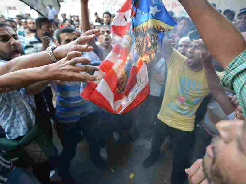 Egyptian protesters burn the US flag during a demonstration against a film deemed offensive to Islam on September 12, 2012 outside the US embassy in C