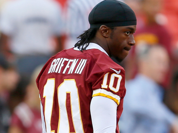 Washington Redskins quarterback Robert Griffin III watches from the sidelines. RG3 as he is known has a fan in other thirds like Frank Deford. (Getty Images)