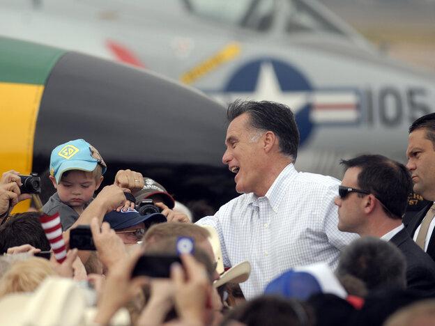 Republican presidential nominee Mitt Romney shakes hands at an aircraft museum in Pueblo, Colo., Monday.