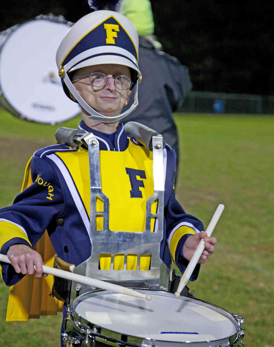 Sam Berns, 15, who has the very rare premature-aging disease progeria, plays the drums in his high school's marching band.