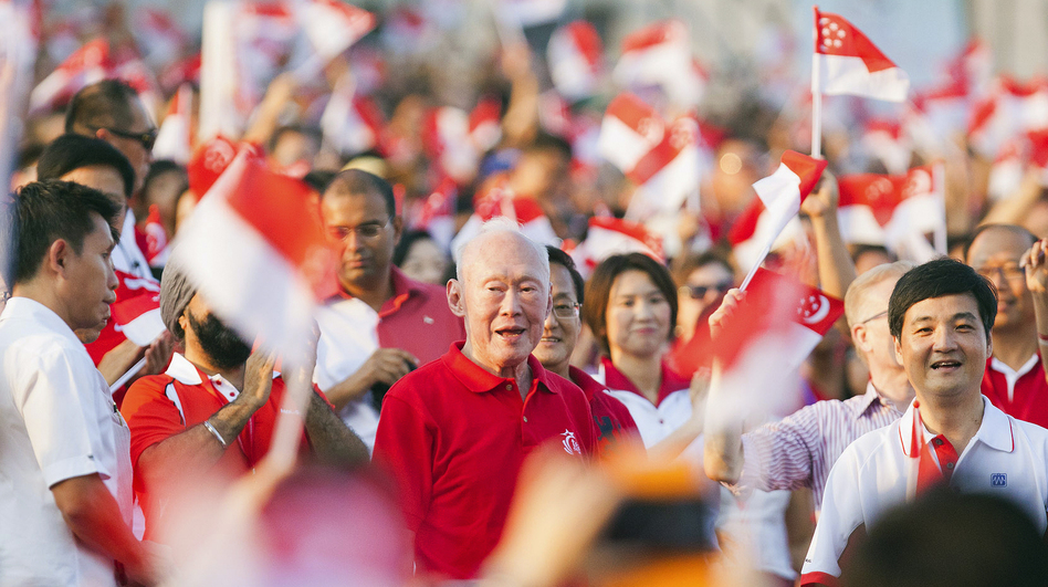 The crowd cheers as Singapore's former Prime Minister Lee Kuan Yew (C) arrives for the annual National Day Parade celebrations in Singapore, Aug. 9. Critics of what they say are the city-state's repressive laws say Lee, Singapore's founding father, used laws such as the Internal Security Act to quash dissent.