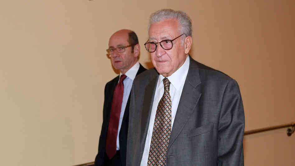 Lakhdar Brahimi, right, joint special representative for Syria, arrives at closed door consultations regarding the situation in Syria a