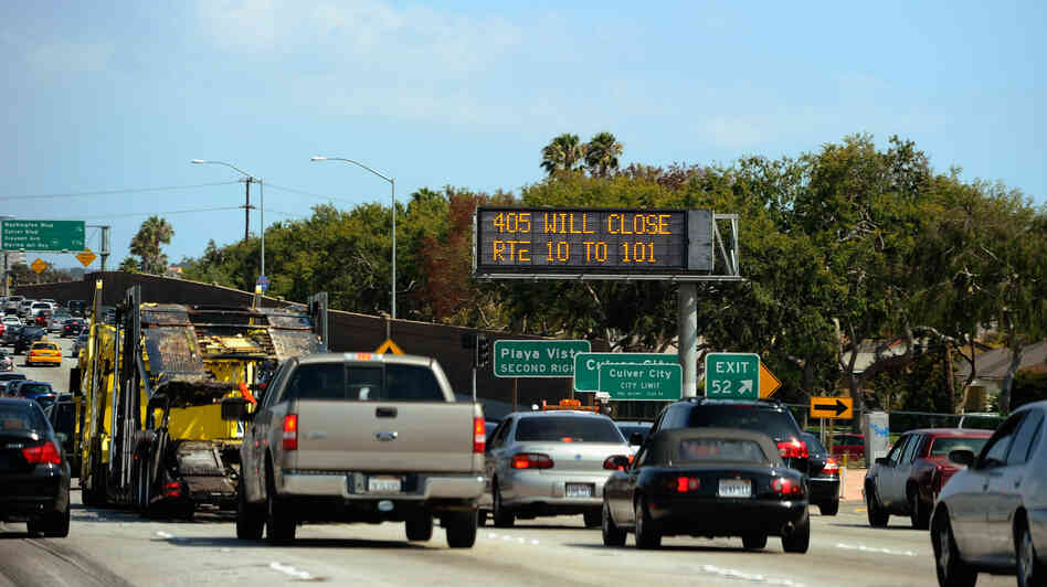Carmageddonin' It? In a photo from last year, a traffic signs alerts motorists on Interstate 405 that the freeway will be shut down for two days in July for demolition of the Mulholland Bridge. The city is bracing for Carmegeddon II, scheduled for this weekend.