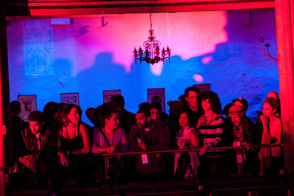 Audience members on the second-floor-balcony of