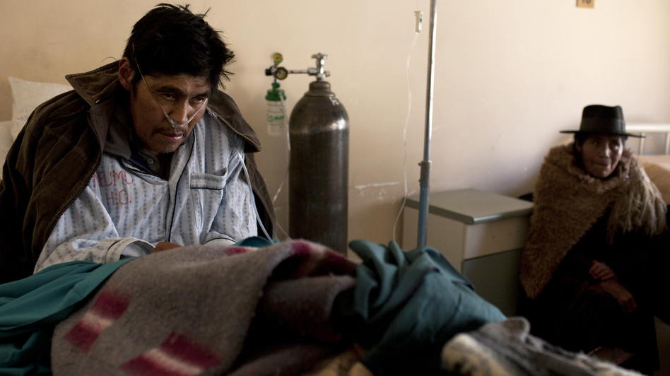 Saturnino Soncko, 58, has been inhaling the fine dust at the silver mines of Cerro Rico for years. He is now extremely ill, gasping for breath in the pulmonary wing of a public hospital in Potosi, Bolivia. (Carlos Villalon for NPR)