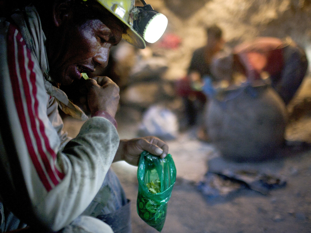 Elogio Tola, 45, a miner since he was a boy, takes a break with coca leaves, chewing bagfuls to ward off hunger and exhaustion in the Cerro Rico silver mines in Potosi last month.
