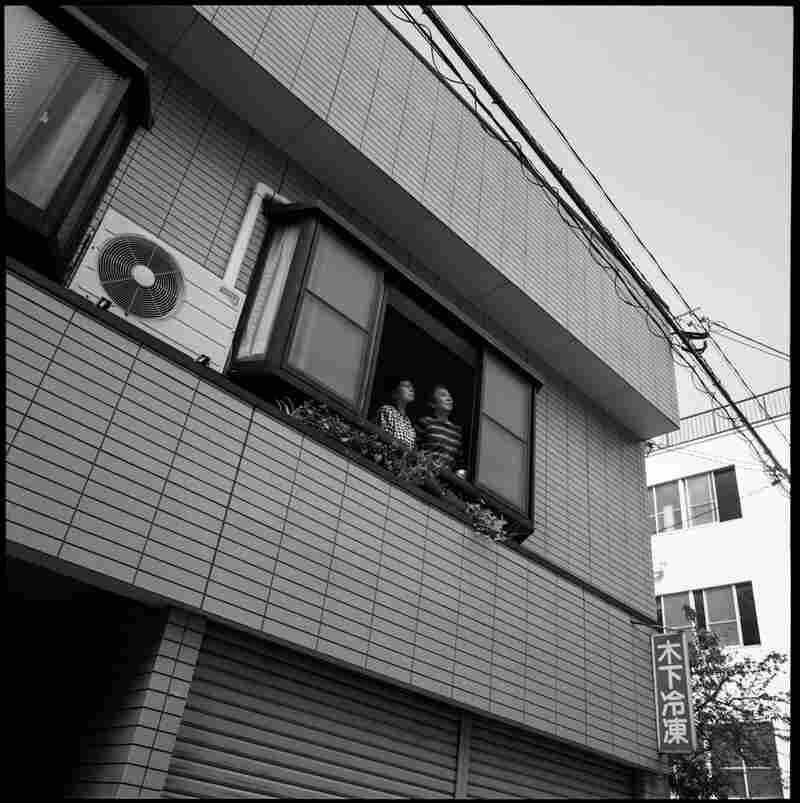 Taniguchi is seen with her sister at their family home, which was rebuilt in the same location where it had stood in 1945. Taniguchi had never heard her sister talk about her experience during the bombing until they were interviewed by photographer Peter Blakely in 2005.