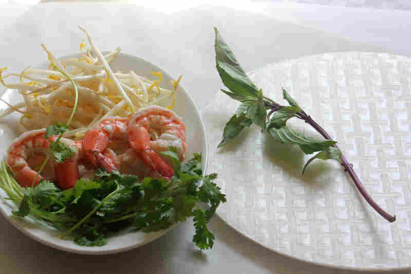 Ingredients for Classic Summer Rolls, including bean sprouts, shrimp, rice paper and fresh mint and cilantro