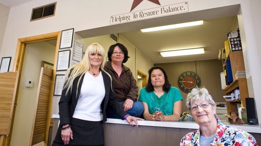 Gayle Kocer (right) helps run the Tiospaye Addiction Recovery Center, one of the few addiction centers serving Pine Ridge. She too says suing beer makers isn't the answer. Also pictured (from left): Suzy Dennis, Tracee Livermont and Sherry Peck, who also work at Tiospaye.
