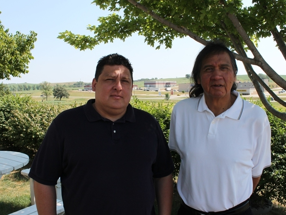 Winnebago tribe members Lance Morgan (left) and Frank LaMere are pushing for Whiteclay's liquor stores to be shut down. (Robyn Wisch for NPR)