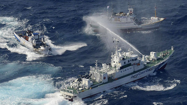 China, Japan and Taiwan all claim the Senkaku-Diaoyu islands as sovereign territory. On Tuesday, coast guard vessels from Japan and Taiwan dueled with water cannons after dozens of Taiwanese boats escorted by patrol ships sailed into waters around the islands. (AFP/Getty Images)