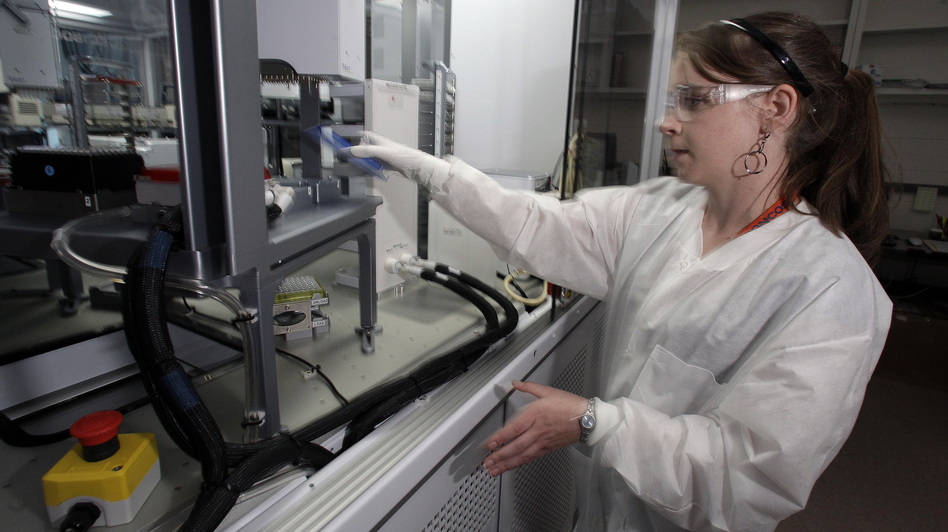 Cheryl Gleasner, a research technologist at the Los Alamos National Laboratory, works with a genome sequencing machine designed for disease surveillance. Since the SARS epidemic in 2003, advances in sequencing technologies have greatly speed up the ability to detect and track a new virus. (AP)