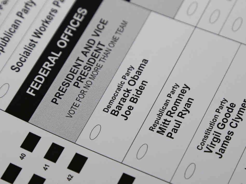 The names of candidates for president and vice president are seen on a ballot at the Polk County Election Office on Wednesday in Des Moines, Iowa. Early voting in Iowa begins Thursda