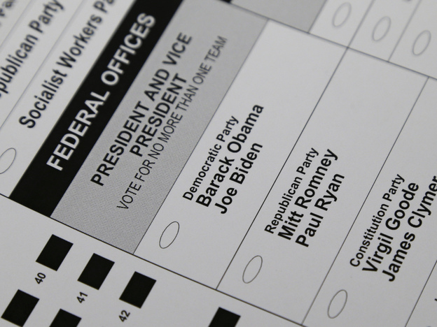 The names of candidates for president and vice president are seen on a ballot at the Polk County Election Office on Wednesday in Des Moines, Iowa. Early voting in Iowa begins Thursday. (AP)