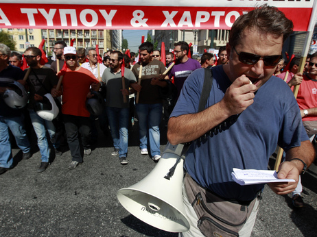 In Athens today, anti-austerity demonstrations began peacefully. Later, protesters threw rocks and petrol bombs. Police responded with tear gas.