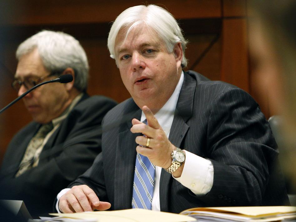 Iowa Supreme Court Justice David Wiggins, right, faces a retention vote Nov. 6.