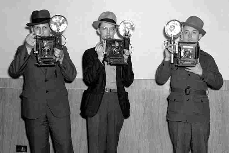 Raymond Hodde (left) was hired in 1930 and was the State Journal's first full-time staff photographer. He was joined later in the decade by Joe Imlay (center) and Charlie Bilyeu.