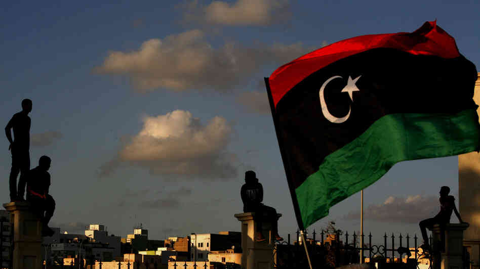 Libyans watch the protest against Ansar al-Shariah Brigades and other Islamic militias, in Benghazi on Sept. 21. The recent attack that killed the U.S. ambassador and three other Americans has sparked a backlash among frustrated Libyans against the heavily armed gunmen, including Islamic extremists, who run rampant in their cities.