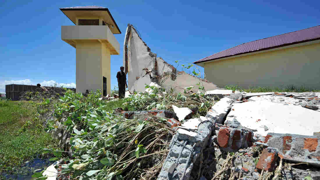 A prison official examines the damage a day after a powerful earthquake hit the west coast of Indonesia in Banda Aceh on April 12.