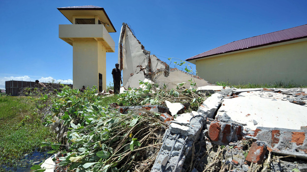 A prison official examines the damage a day after a powerful earthquake hit the west coast of Indonesia in Banda Aceh on April 12. (AFP/Getty Images)
