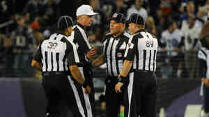 Things haven't been going well for these guys: Some of the NFL's replacement referees, during a Sept. 23 game between the New England Patriots and Baltimore Ravens.