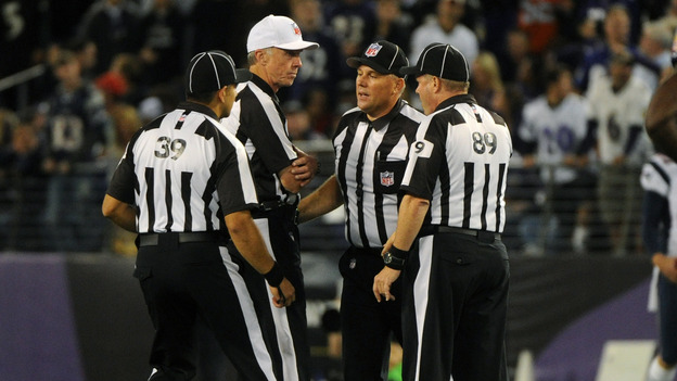 Things haven't been going well for these guys: Some of the NFL's replacement referees, during a Sept. 23 game between the New England Patriots and Baltimore Ravens. (UPI /Landov)