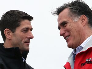 Presidential candidate Mitt Romney and his running mate, Rep. Paul Ryan, share a moment during a campaign rally in Vandalia, Ohio.