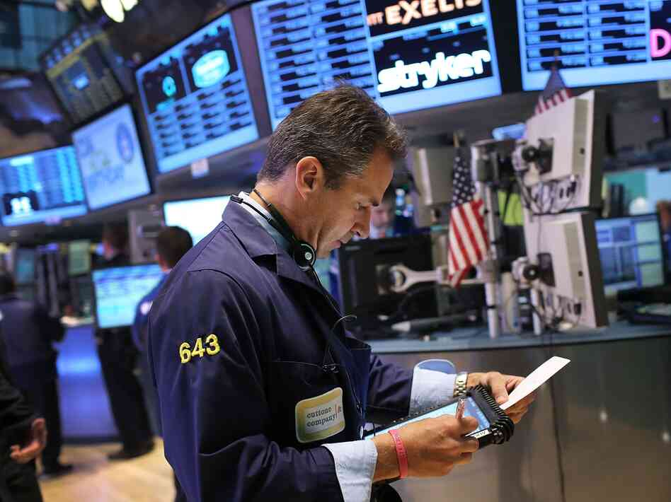 Traders work on the floor of the New York Stock Exchange on September 18, 2012 in New York City.