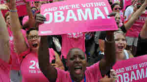 Supporters of Planned Parenthood wave banners during a rally for President Obama in Charlotte, N.C., on Sept. 4, ahead of the opening of the Democratic National Convention.