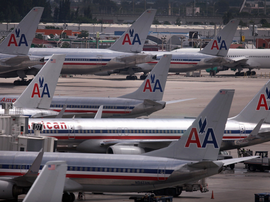 American Airlines planes sit on the tarmac at Miami International Airport this month. Reports indicate that American Airlines has canceled somewhere between 2 and 5 percent of flights in recent days, reportedly blaming a surge in pilot sick days and maintenance write-ups by pilots. (Joe Raedle/Getty Images)