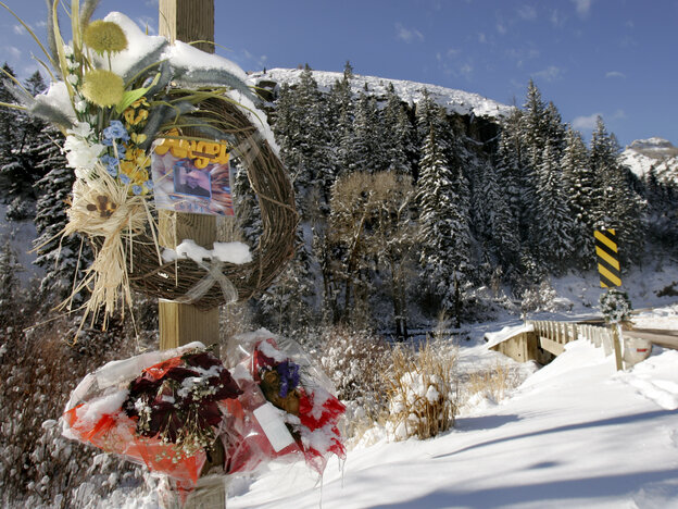 Wreaths and flowers commemorating those killed in the Crandall Canyon Mine collapse are posted at the mine entrance on Dec. 10, 2007, outside Huntington, Utah. A settlement Thursday includes mine owner Murray Energy's acceptance of four violations c