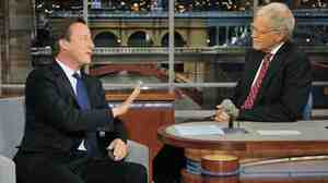 British Prime Minister David Cameron chats with talk show host David Letterman on Wednesday, September 26, 2012.