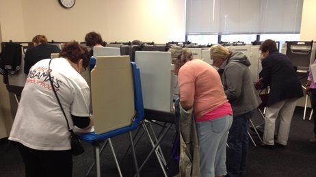 Iowans vote Thursday at the Polk County Auditor's Office in Des Moines. Voters lined up before the doors opened at 8 a.m. to cast ballots. At least 200 people had arrived within the first hour.