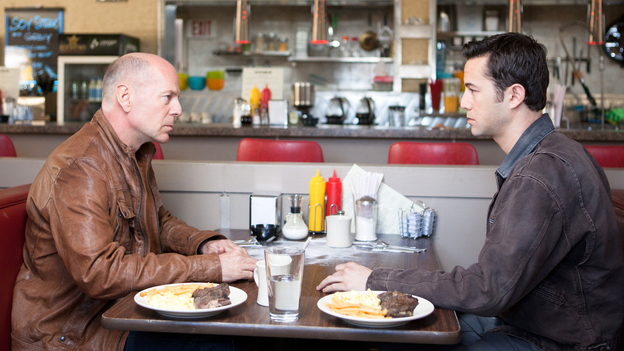 Old Joe (Bruce Willis) and his younger self (Joseph Gordon-Levitt), two iterations of the same assassin, play a particularly personal game of cat and mouse in the time-travel thriller Looper. (Sony Pictures)