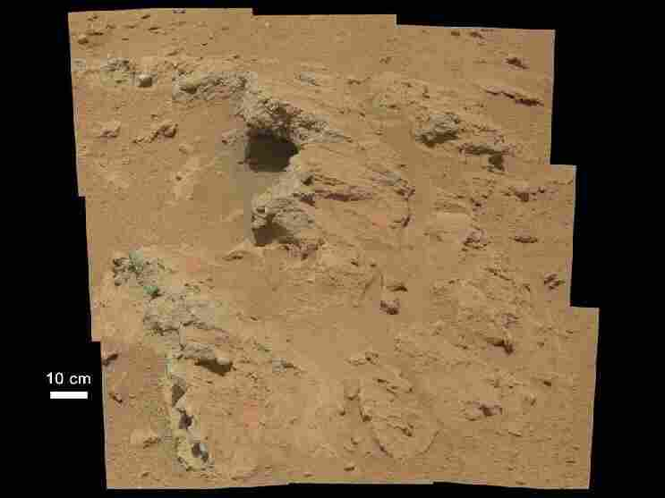 Curiosity 2012: A wider view of the outcrop of a former streambed shows bedrock that scientists believe was likely exposed by meteorites striking the surface of Mars.