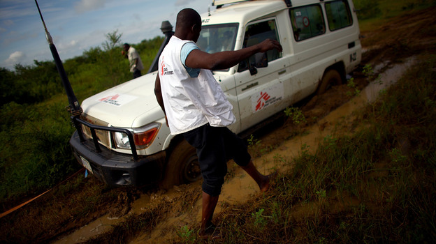 Four-wheel drive is no match for the mud on the road to a gold mine in northern Nigeria. (NPR)