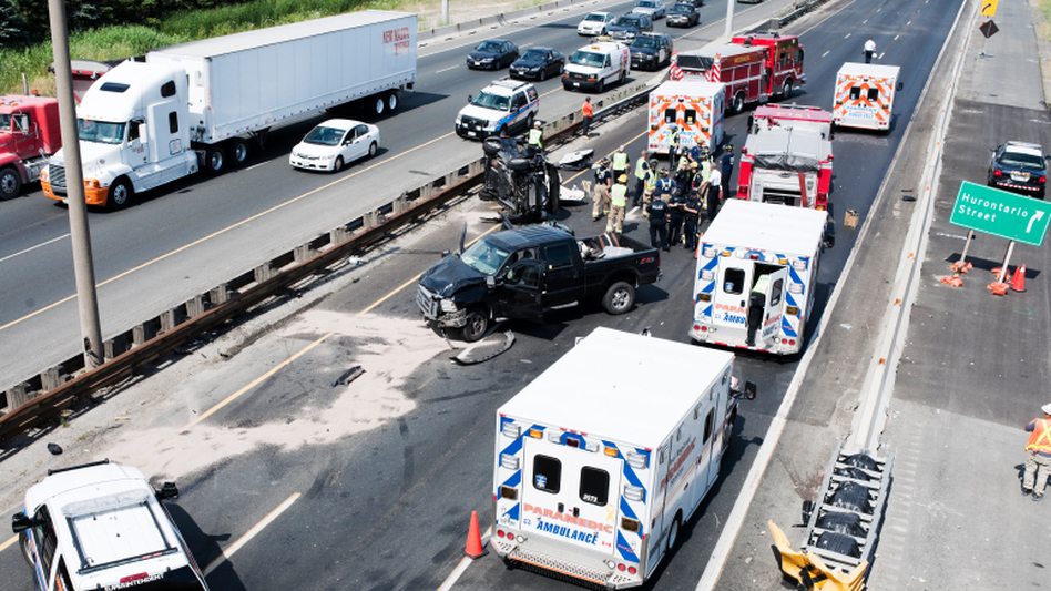 Fire department personnel, police officers and paramedics at the scene of a fatal collision on Highway 401 in Mississauga, Ontario, in July 2011. (iStockphoto.com)