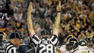 They'll be welcomed back by fans: Regular NFL refs will be on the job again starting tonight. (2006 file photo.)