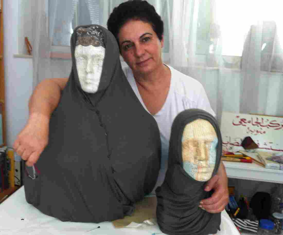 Tunisian artist Nadia Jelassi with two of the sculptures from her exhibit that were attacked by a hard-line Muslim group. Secular Tunisians and Islamists have clashed over multiple issues related to freedom of expression.