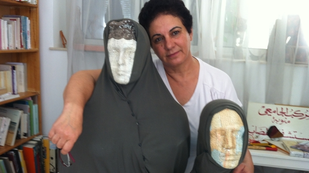 Tunisian artist Nadia Jelassi with two of the sculptures from her exhibit that were attacked by a hard-line Muslim group. Secular Tunisians and Islamists have clashed over multiple issues related to freedom of expression. (NPR)
