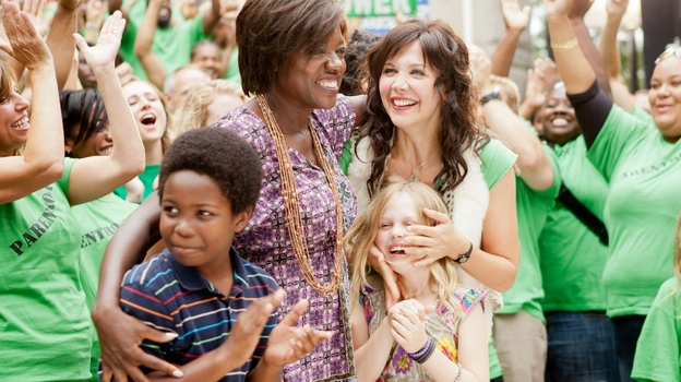 Nona Alberts (Viola Davis) and Jamie Fitzpatrick (Maggie Gyllenhaal) share a triumphant moment with Nona's son Cody (Dante Brown) and Jamie's daughter Malia (Emily Alyn Lind). (20th Century Fox )