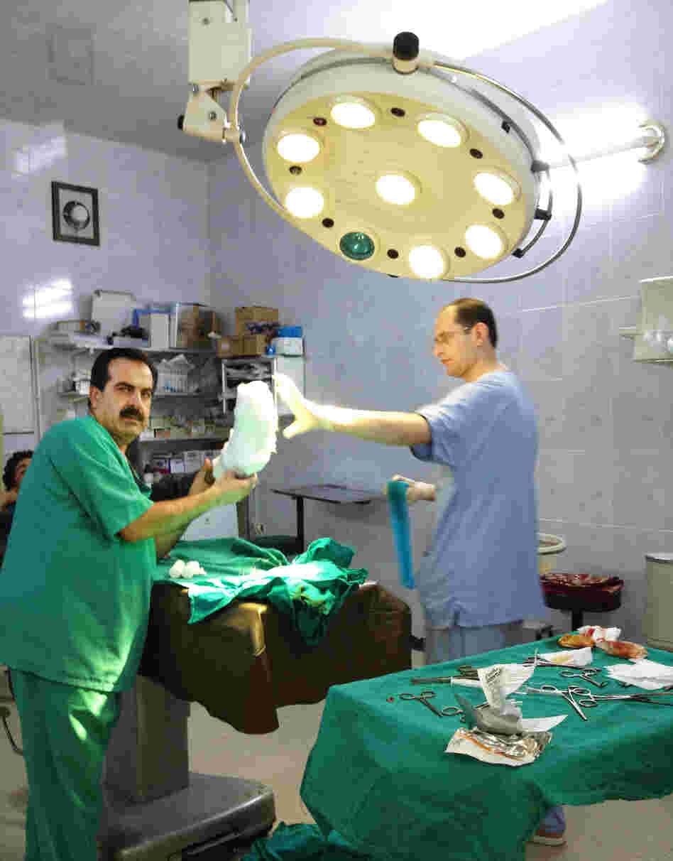 Local Syrian doctors prepare to treat a patient in a field hospital in Aldana, Syria, near the Turkish border. Each day, local and expatriate doctors take big risks to treat the wounded in rebel-held areas.