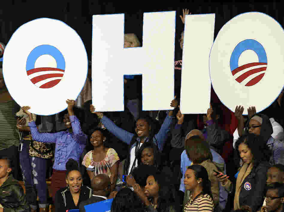 Supporters hold up an Ohio sign as President Obama speaks at a campaign event at Kent State University on Wednesday in Kent, Ohio.