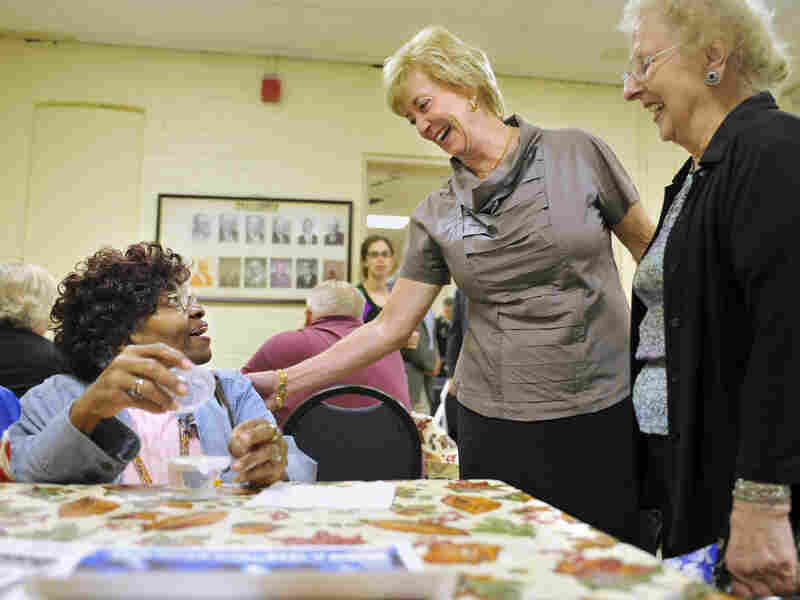 Linda McMahon (center) visits a senior center in Naugatuck, Conn., this month.